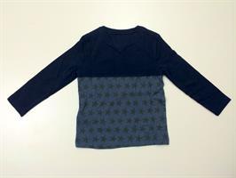 חולצה חצי עליון בצבע כחול חצי תחתון כוכבים כחול של המותג טומי הילפיגר. מס' דגם: 696